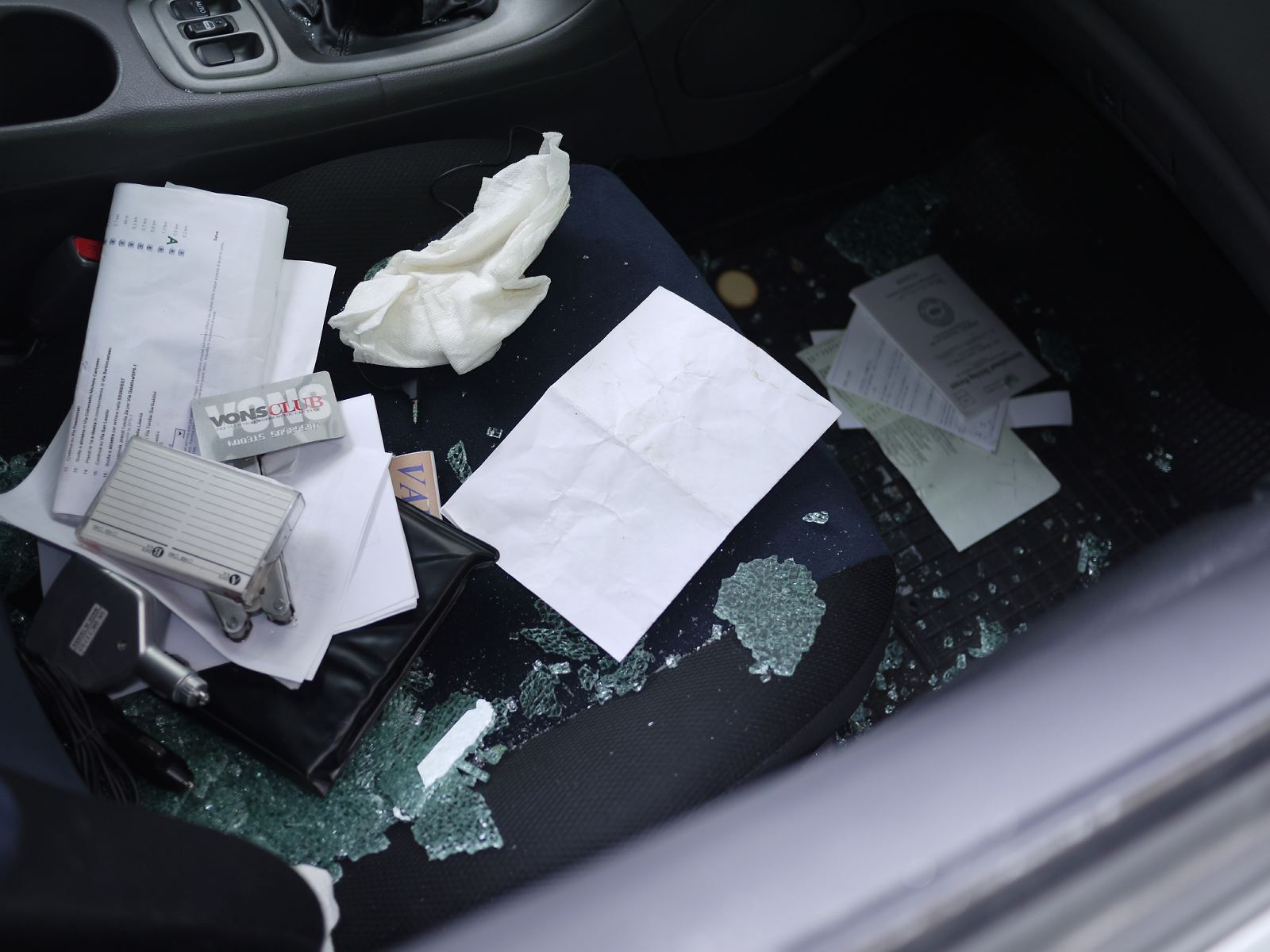 Shards of broken windows on the passenger's side seat