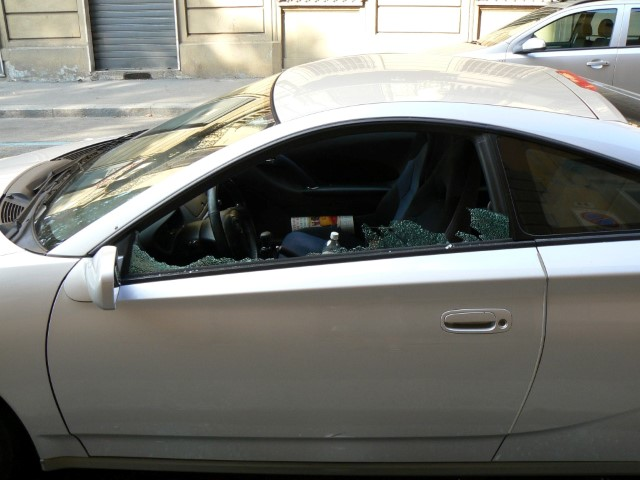 Smashed windows on a car from a break-in in Turin Torino Italy